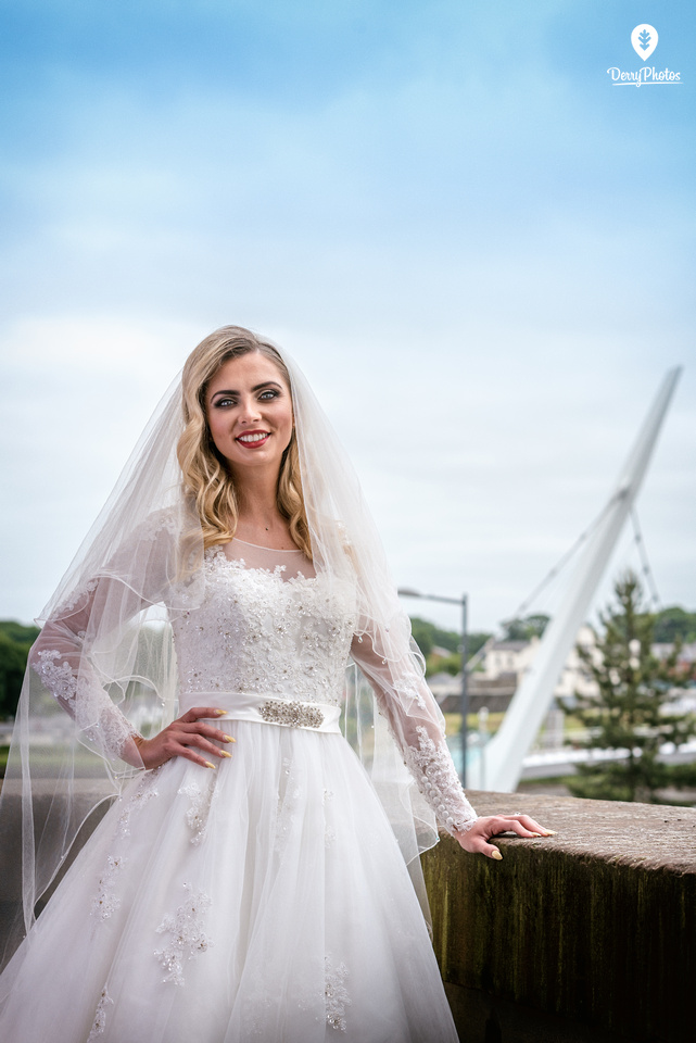 Olivia Doherty Wearing dresses by the Bridal Showroom at the Guildhall Derry Wedding venue. Peace Bridge Background