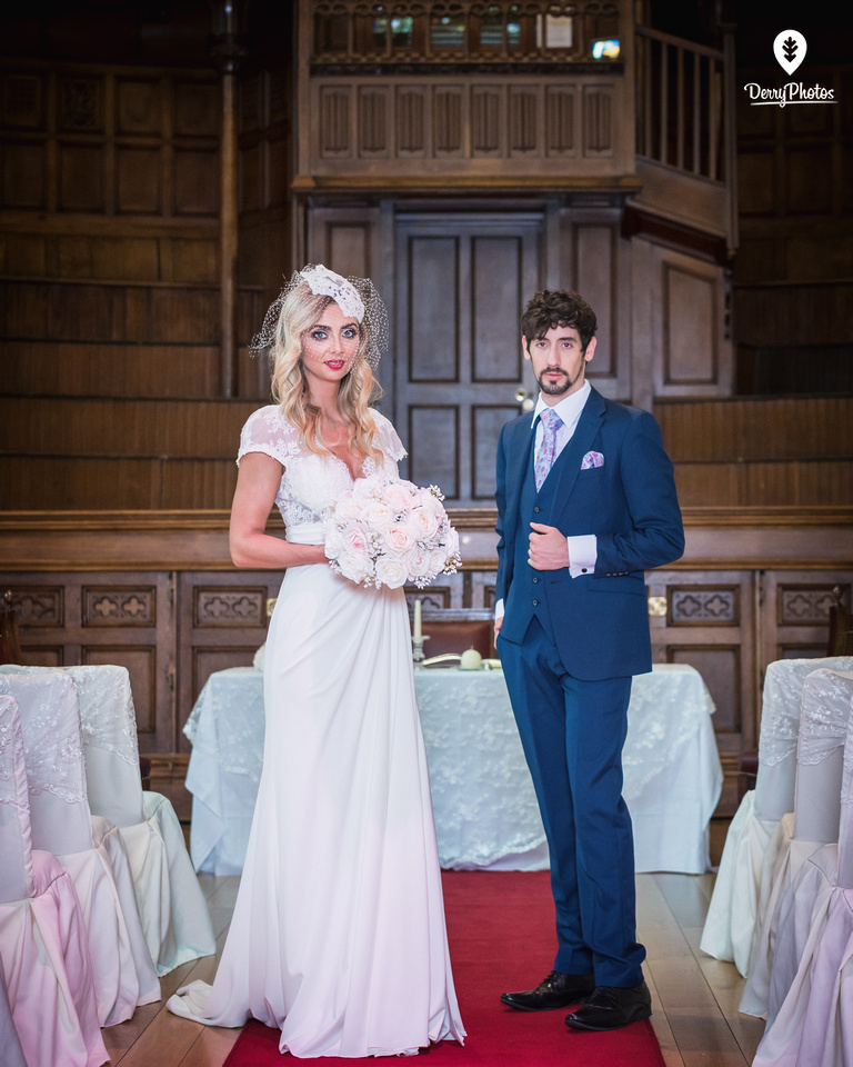 Olivia Doherty and Emmette Dillon, dresses by the Bridal Showroom, at the Guildhall Derry Wedding venue. suits By Black Tie Showrom