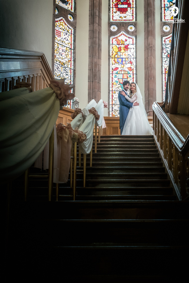 Emmette Dillon & Olivia Doherty Wearing dresses by the Bridal Showroom Suit by The Black Tie Showroom at the Guildhall Derry Wedding venue. Stair dressings by Ultimate Touches